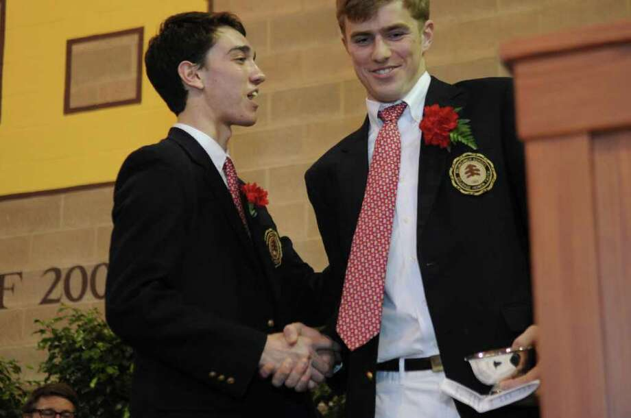 "Brunswick School ""Ivy"" speaker James E. Yacobbucci III, left, shakes hands with Spencer R. Dahl, valedictorian, after Dahl introduced Yacobbucci during the school's 109th commencement on Wednesday, May 25, 2011. Photo: Helen Neafsey / Greenwich Time"