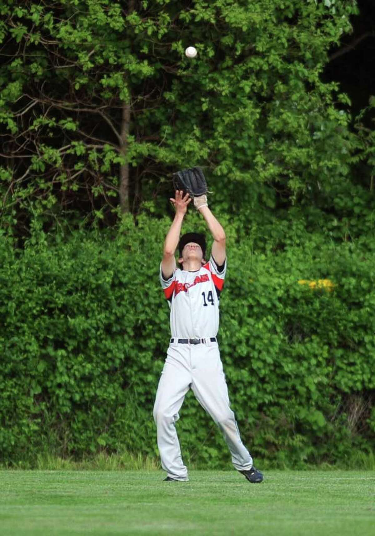 New Canaan's Matthew Sammarco makes a catch in the outfield during Wednesday's FCIAC quarterfinal game at Staples High School on May 25, 2011.