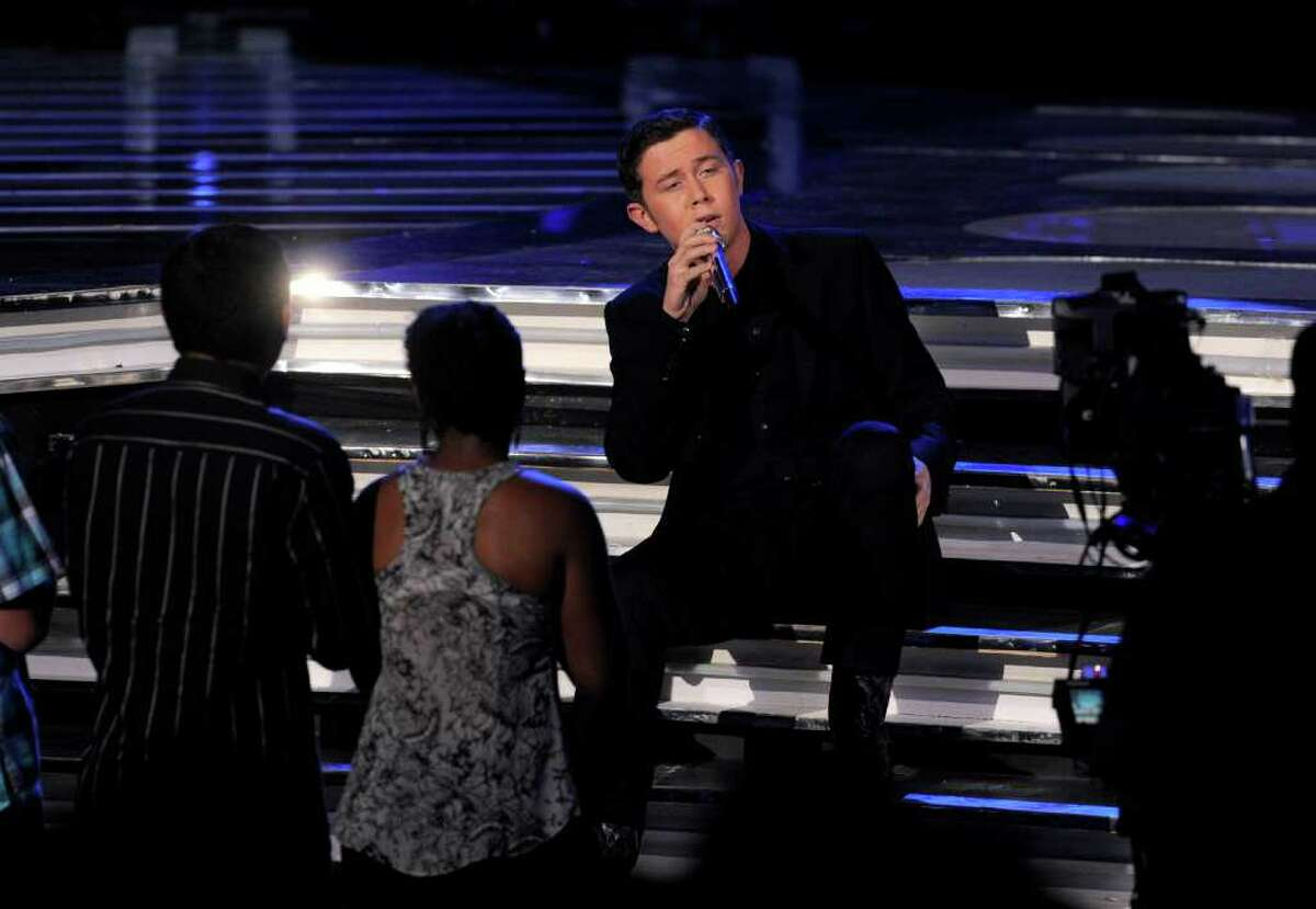 """Scotty McCreery performs at the """"American Idol"""" finale on Wednesday, May 25, 2011, in Los Angeles. (AP Photo/Chris Pizzello)"""
