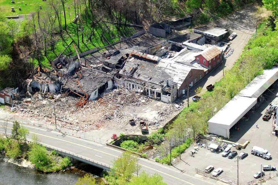 Work was set to begin on the demolition of the formerHousatonic Wire Co.site, left in rubble following a massive fire in September2010. FILE PHOTO/Morgan Kaolian AEROPIX Photo: Morgan Kaolian AEROPIX / Morgan Kaolian AEROPIX