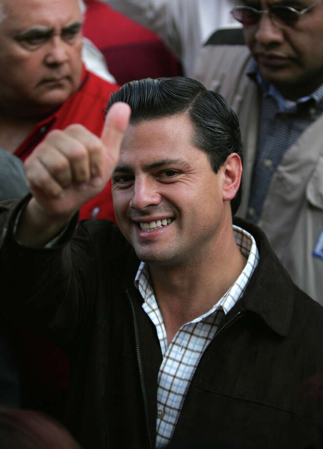 In this July 3, 2005 file photo, Enrique Pena Nieto, then candidate of the Institutional Revolutionary Party, for governor of the state of Mexico, gives the thumbs up sign as he arrives at a voting station to cast his vote in the city of Atlacomulco, Mexico. Photo: Associated Press/File
