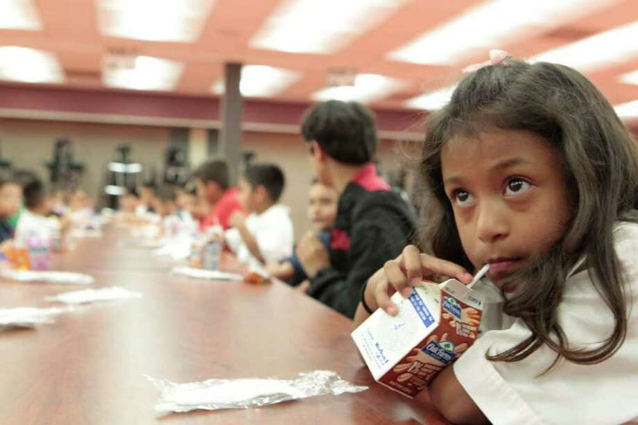 Kindergardener Alondra Landeros takes a sip of milk as she gathers with her classmates Wednesday for an after-school program at Youens Elementary. Census shows that Texas is younger because of the young Hispanic population. Youens Elementary school is 60 to 70 percent Hispanic. (Billy Smith II / Houston Chronicle) Photo: Billy Smith II / 2011 Chronicle
