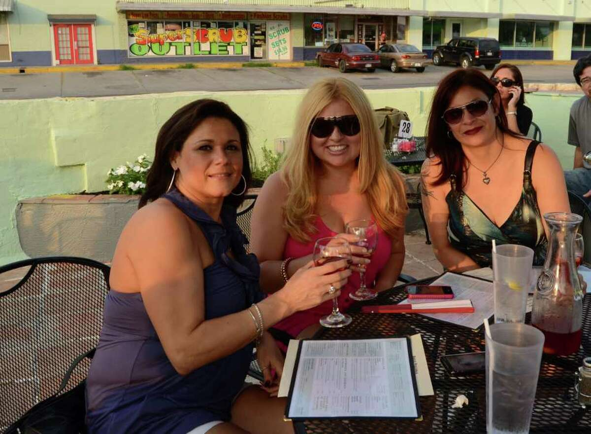 Friends Lisa Aldaco (left), Yvonne Roman and Karen Torres have their sangrias in sunlight on the patio of Deco Pizzeria. ROBIN JOHNSON / SPECIAL TO THE EXPRESS-NEWS