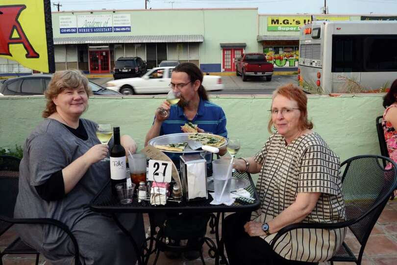 Avigail NiNamara (left), David Wagner and Sue Duffy liked what the ate and tasted at Deco Pizzeri