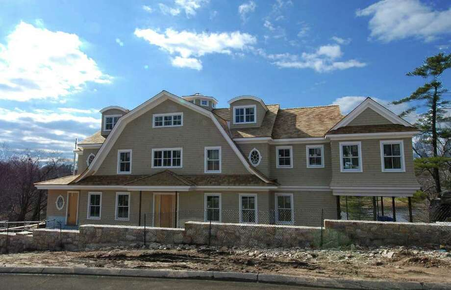 This waterfront colonial, being constructed by builders Joseph and Frank Tomas of Wilton, is slated for completion by mid-summer. Photo: Contributed Photo