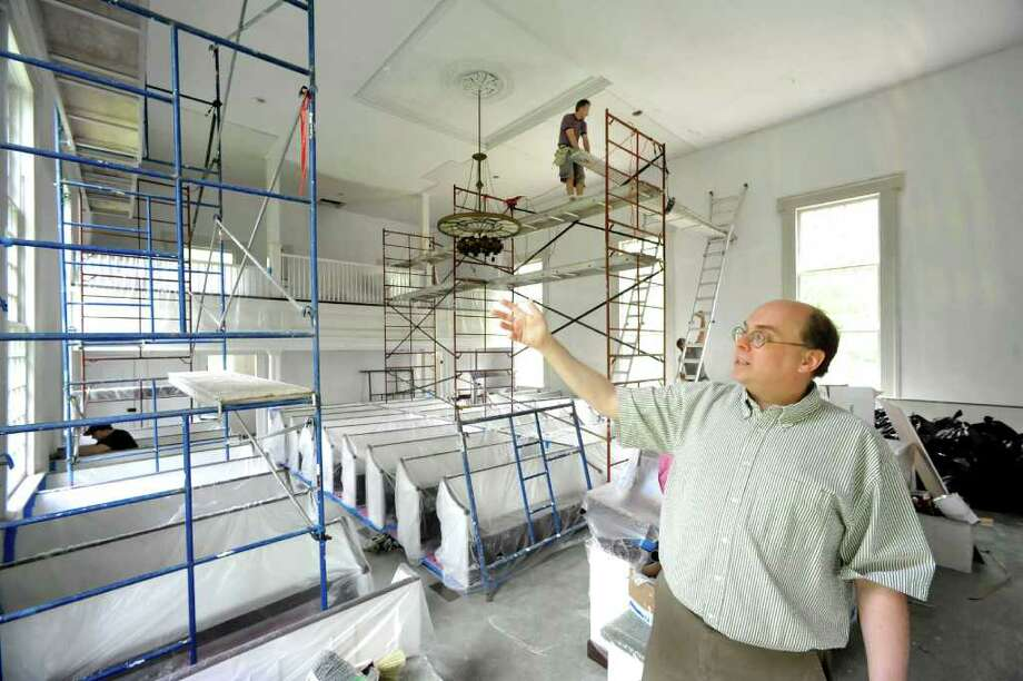 Rev. John Heeckt talks about the renovations under way inside Ridgebury Congregational Church in Ridgefield, Thursday, May 26, 2011. Photo: Michael Duffy / The News-Times