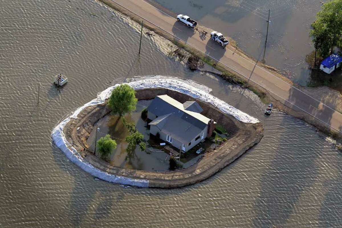A levee protects a home surrounded by floodwater from the Yazoo River May 18, 2011 near Vicksburg, Miss.