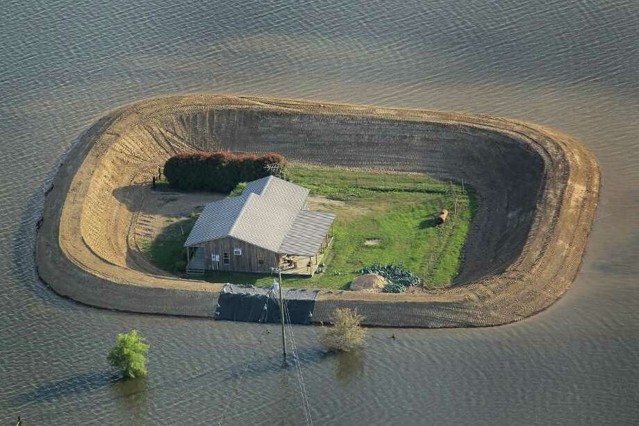The good news for these homeowners near Vicksburg, Miss., is that their levees protected their homes from the flooding Yazoo River in May. The good or bad news, depending on how one looks at it, is that they now have island homes. Photo: Scott Olson, Getty Images / 2011 Getty Images