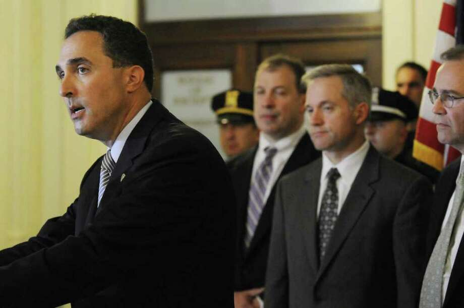U.S. Attorney Richard Hartunian, left, speaks during a press conference to announce the arrest of dozens of people busted in an FBI investigation in Schenectady, NY, on Thursday, May 26, 2011.( Michael P. Farrell/Times Union ) Photo: Michael P. Farrell