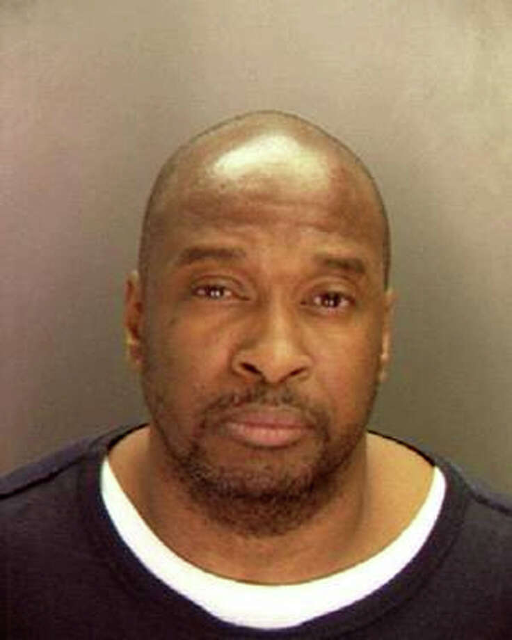Adolph Sharp, 53, was arrested Wednesday by members of the U.S. Marshal Violent Crime Fugitive Task Force and Syracuse police. Police said Sharp, who has an extensive criminal record including convictions for assault, burglary and drug selling, is accused of beating and stabbing Sherryl Thomas to death in her Adams Street home in April 2008. Photo: Contributed Photo / Connecticut Post Contributed