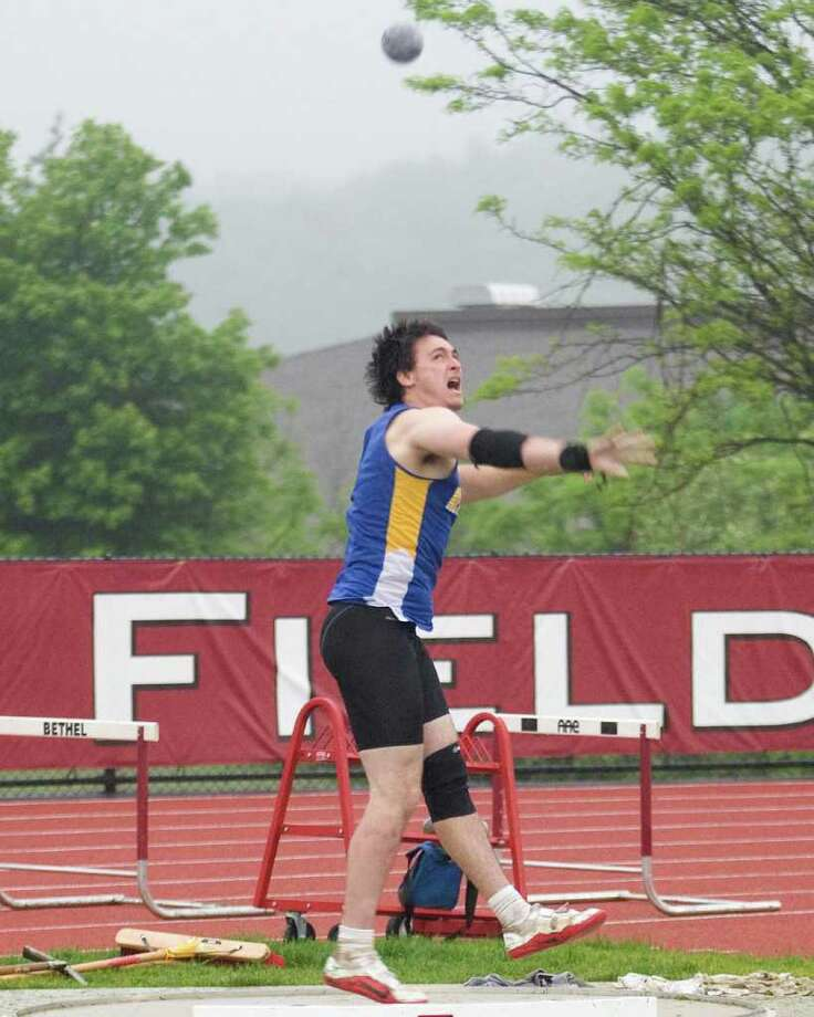 Newtown's John Wlasuk notched his third first place finish by winning the shot put at the SWC Track and Field Championships Monday at Bethel High School. Wlasuk also won the discus and javelin. Photo: Barry Horn / The News-Times Freelance