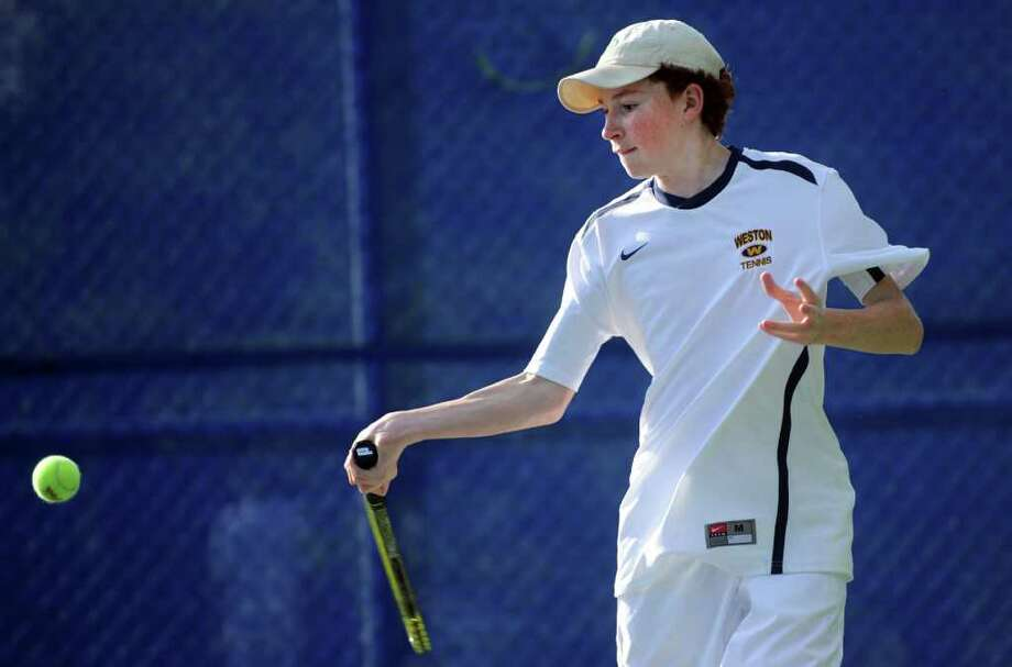 Weston's Jack Lawless returns the ball during his doubles match against Pomperaug in the SWC finals Wednesday, May 25, 2011 at Weston High School. Photo: Autumn Driscoll / Connecticut Post