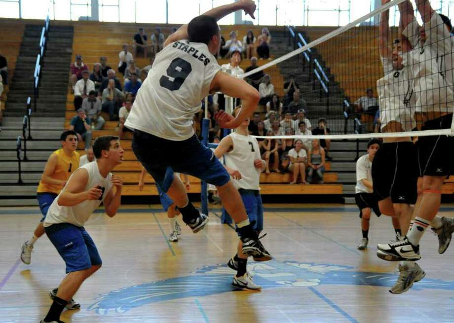 Staples senior quad-captain lefty Steven Denowitz goes for the kill in the FCIAC semifinals against Ridgefield Wednesday. Denowitz had 11 kills in the second-seeded Wreckers' 3-1 victory. Photo: Contributed Photo / Suzanne Kalb