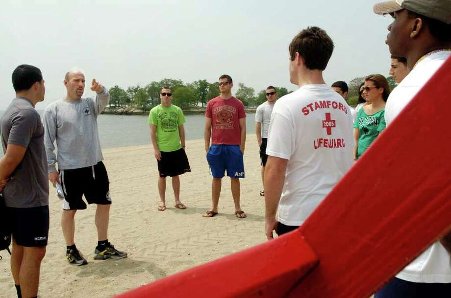 A class of City of Stamford life guards get a course on emergency response procedures at Cove Beach with  instructor, Scott Beauregard in Stamford, Conn. on Thursday May 26, 2011. Photo: Dru Nadler / Stamford Advocate Freelance
