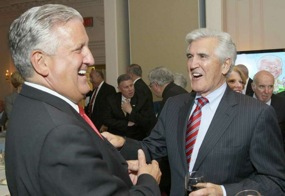 Mayor Jerry Jennings, left, jokes with former Senate Majority Leader Joseph Bruno before the John McLoughlin Roast to benefit The John McLoughlin Fund, part of the Endowment at the Center for Disability Services, on May 17, 2011, in Albany, N.Y. Bruno later commented from the podium that, considering the alternative, he was very glad to be at the roast. (Photo by Joe Putrock / Special to the Times Union).