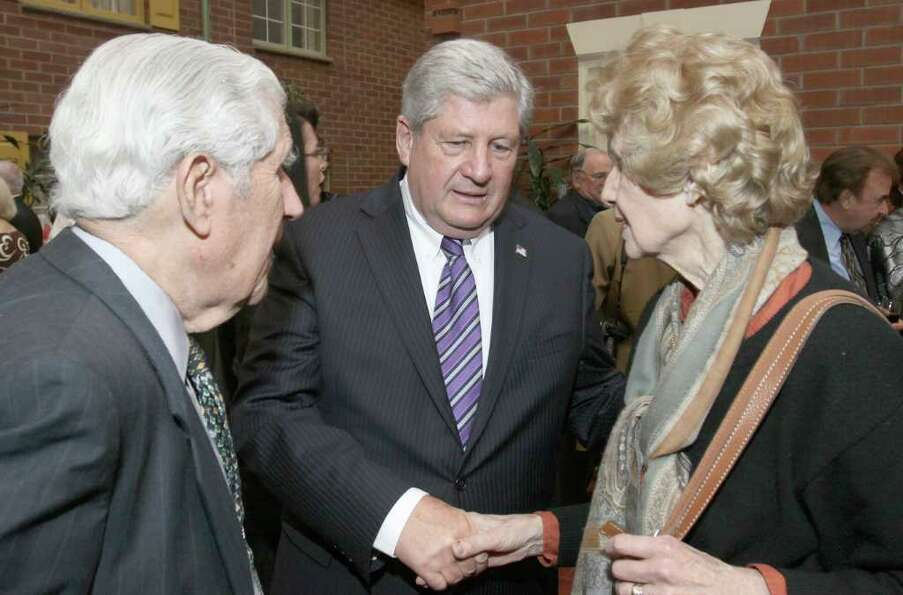 Senator Roy McDonald, center, talks with former Albany County District Attorney Sol Greenberg and hi