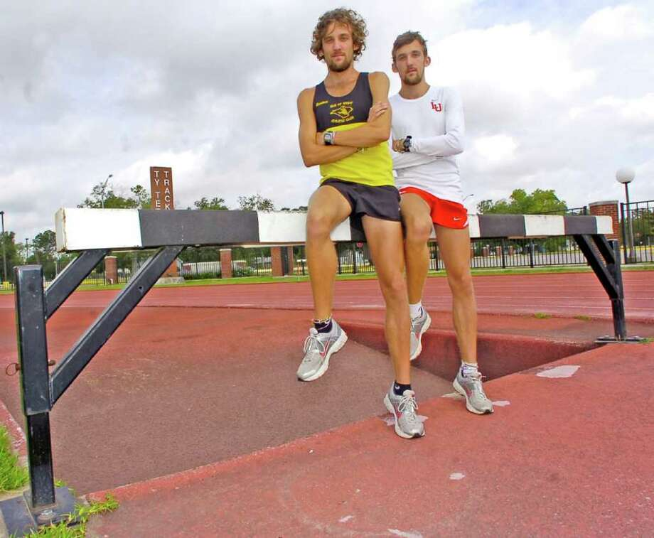 Lamar University track athletes Tom Wade, right, and Joe Wade, left, will compete May 26-28 at the NCAA Championships in Eugene, Ore. They are twin brothers who will compete in the 3,000 meter steeplechase. Their coach says he could not tell them apart for the first two months they were on campus.Now they have changed their hairstyles to make telling them apart easier. Dave Ryan/The Enterprise Photo: Dave Ryan