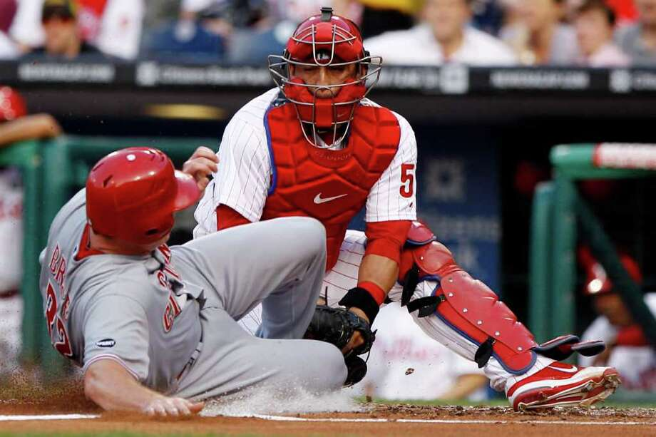 Cincinnati Reds' Jay Bruce, left, is tagged out at home plate by Philadelphia Phillies catcher Carlos Ruiz after trying to score on a fielder's choice by Edgar Renteria in the second inning of a baseball game on Wednesday, May 25, 2011, in Philadelphia. Renteria was safe at first. (AP Photo/Matt Slocum) Photo: Matt Slocum, STF / AP