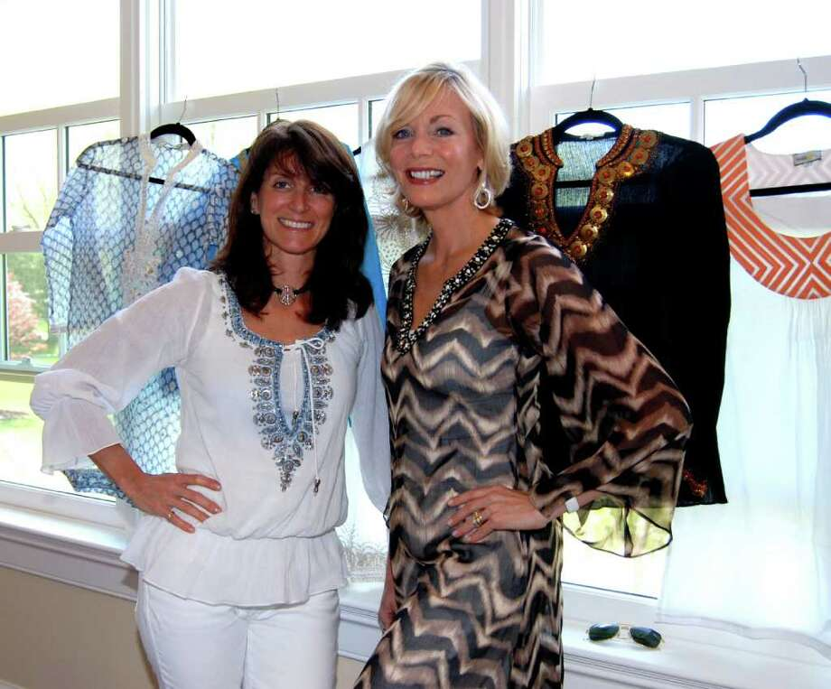 Marea Dumbauld and Jeanne Daniel display their beautiful hand crafted tunics and specialty tops at a recent event.  Their company, bella-tu, has been getting a lot of attention by stores locally, in NYC, and all across the United States.  Even The Four Seasons in Punta Mita, Mexico, carries their very unique line of tops. Photo: Jeanna Petersen Shepard / New Canaan News