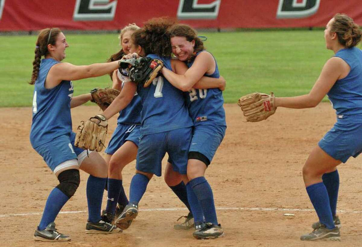 Darien celebrates its win over Stamford, during FCIAC girls softball semi-final action at Fairfield University in Fairfield, Conn. on Thursday May 26, 2011.
