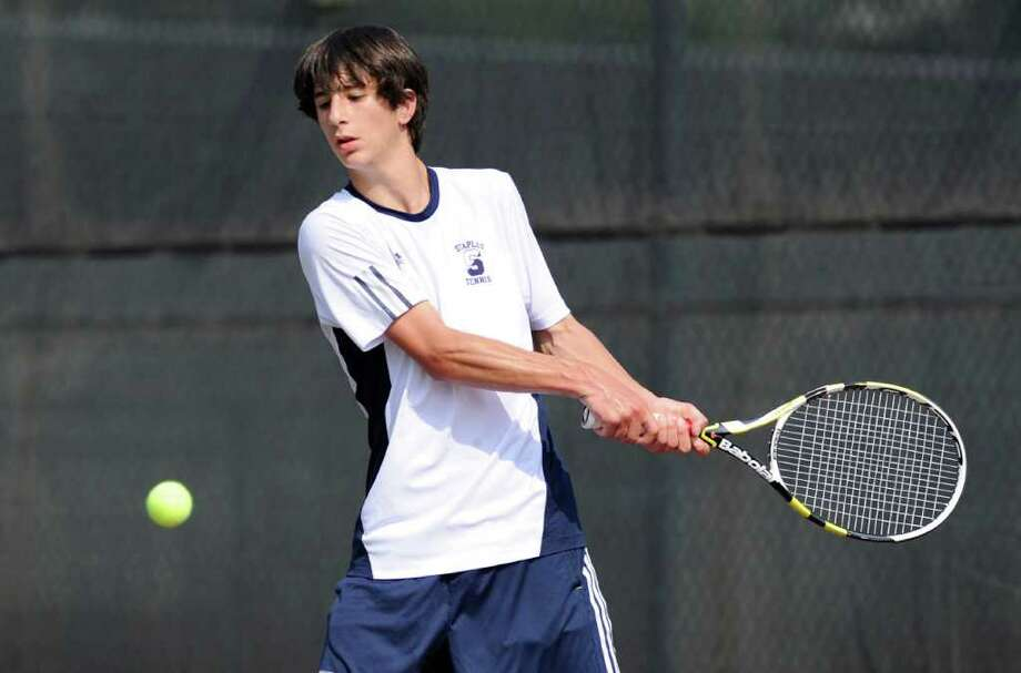 Jake Hirschbeg of Staples High School in action against Andrew Blumberg of Greenwich High School in the FCIAC boys high school tennis final between Greenwich High School and Staples High School at Wilton High School, Thursday afternoon, May 26, 2011. Photo: Bob Luckey / Greenwich Time