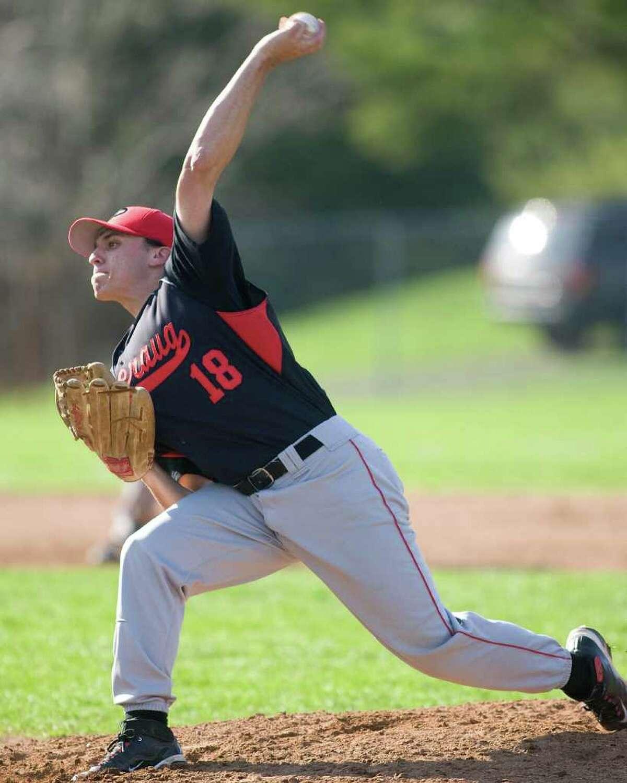 Pomperaug's Dan Fein fires a pitch against Bethel Thursday at Bethel High School.