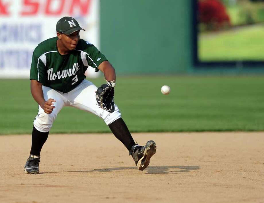 Norwalk's Napoleon Fleming makes a play during Thursday's FCIAC semifinal game at the Arena at Harbor Yard on May 26, 2011. Photo: Lindsay Niegelberg / Connecticut Post