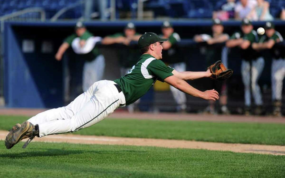 Norwalk pitcher Spencer Jacoby makes a diving catch from the mound during Thursday's FCIAC semifinal game at the Arena at Harbor Yard on May 26, 2011.