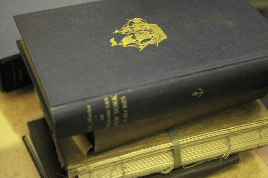 A book about the settlement of what is now New York City is seen on top of a stack of books at the New Netherland Research Center at the New York State Museum on Thursday morning, May 26, 2011 in Albany.  Allison van Laer, the great granddaughter of A.J.F. van Laer brought in books, papers and photographs of her great grandfather to the center.  A.J.F. van Laer was  a librarian and archivist with the New York State Library at the time of the Capitol fire.  (Paul Buckowski / Times Union) Photo: Paul Buckowski  / 00013307A