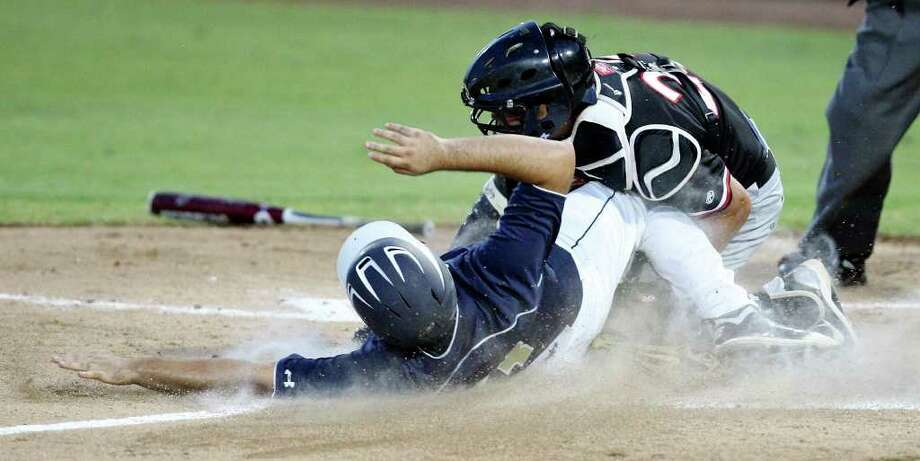 Laredo Alexander's Patrick Alarcon is tagged out at home by Churchill's R.J. Recio during the second  inning in game 1 of the Class 5A regional semifinal baseball series held on Thursday May 26, 2011 at Wolff Stadium. Photo: Edward A. Ornelas/Express-News / SAN ANTONIO EXPRESS-NEWS (NFS)