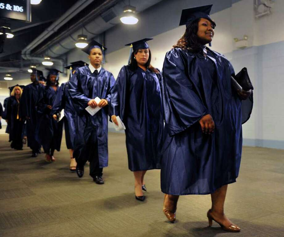 Graduates walk in the processional during the Housatonic Community College graduation at the Webster Bank Arena at Harbor Yard on Thursday, May 26, 2011. Photo: Lindsay Niegelberg / Connecticut Post