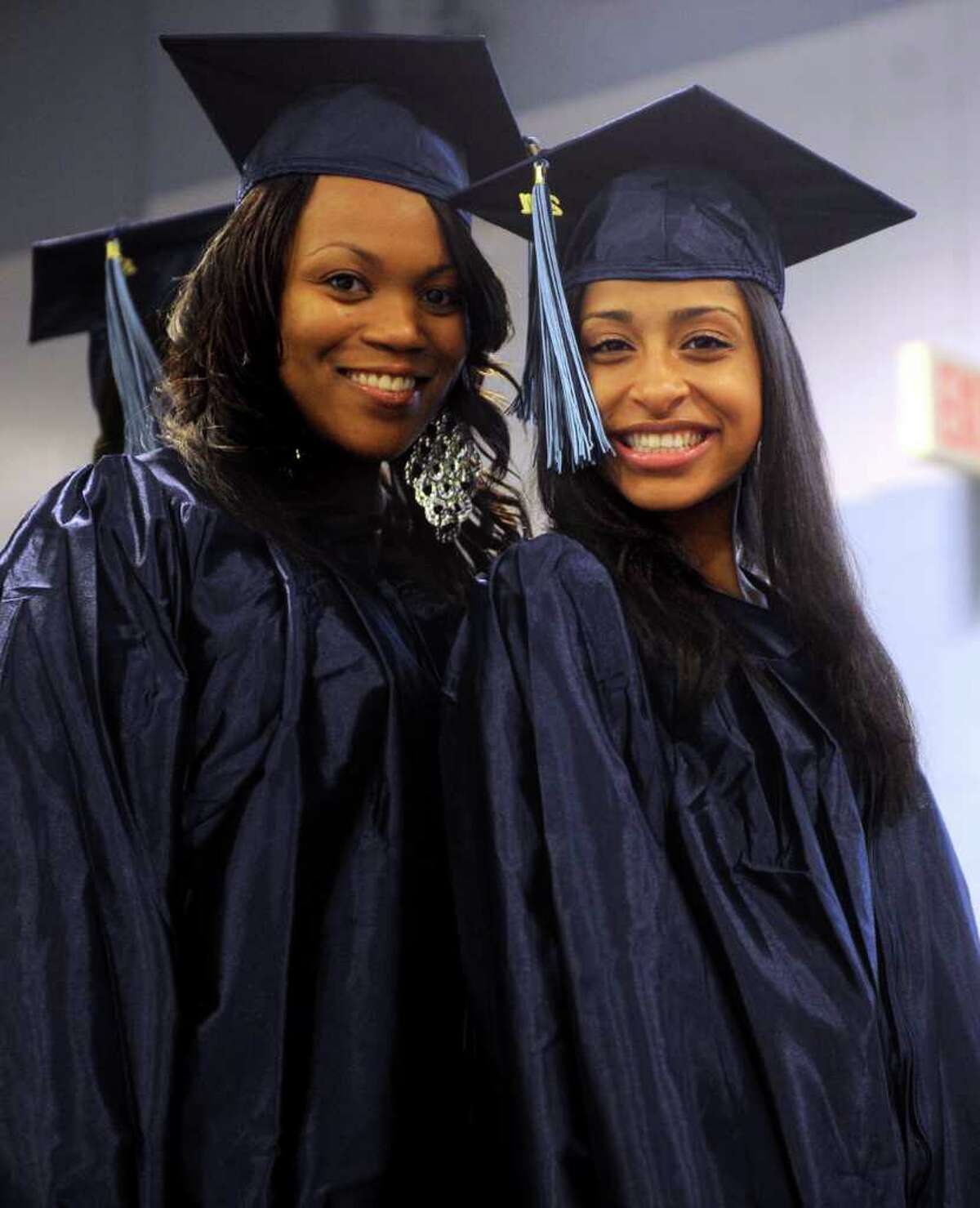 Desirae Williams of Stratford, left, and Marissa Ortiz of Oxford pose for a photo before the processional begins during Housatonic Community College graduation at the Webster Bank Arena at Harbor Yard on Thursday, May 26, 2011.