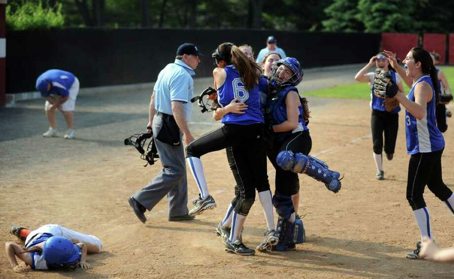 Fairfield Ludlowe celebrates as Danbury runner Kristy Trotta lays on the ground after getting tagged between third and home Thursday, May 26, 2011 during the FCIAC softball semifinal game at Fairfield University. Photo: Autumn Driscoll / Connecticut Post