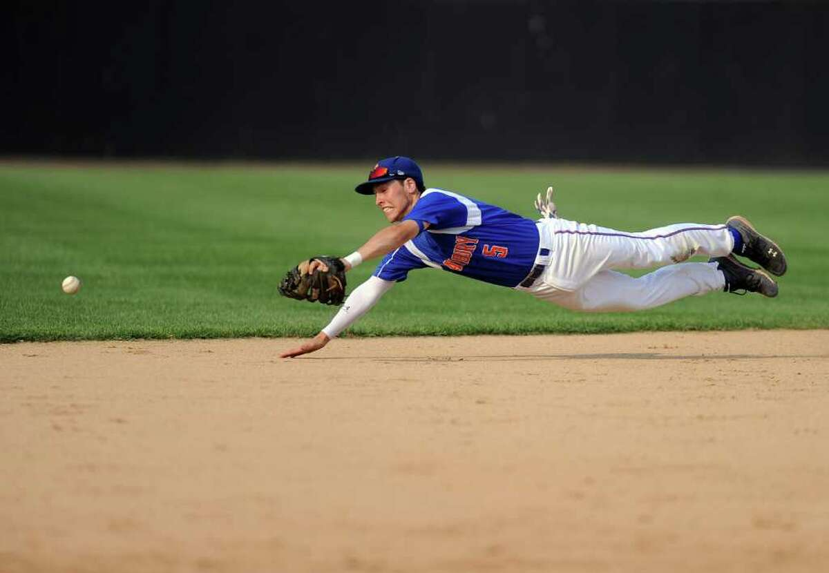Danbury's Robbie Meerman dives for a ball during Thursday's FCIAC semifinal game at the Arena at Harbor Yard on May 26, 2011.
