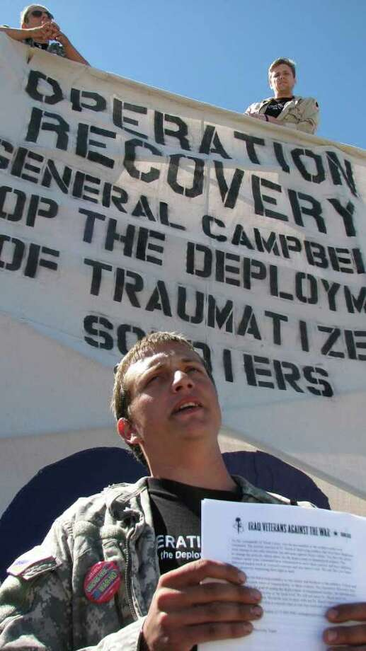Kyle Wesolowski, who served in the Army in Iraq, speaks at a protest outside Fort Hood. The protesters are seeking a sit-down with Fort Hood's commander, Lt. Gen. Don Campbell Jr. Photo: Sig Christenson