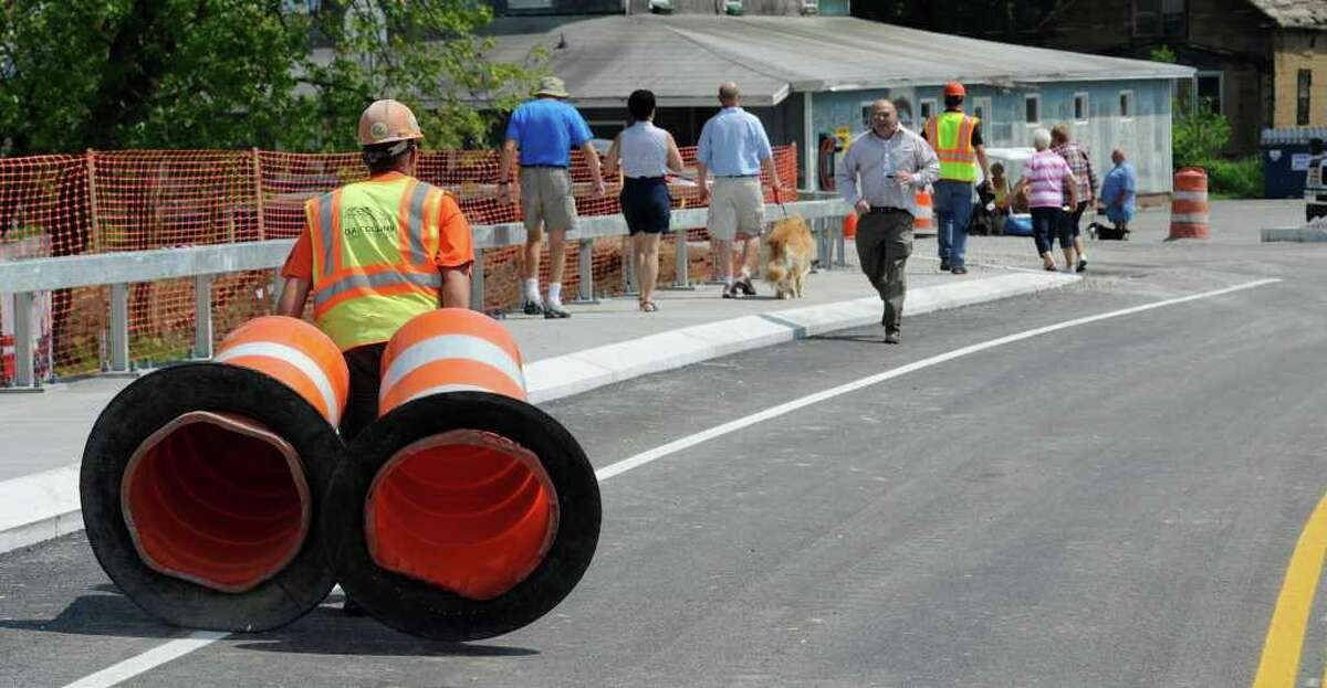 NYS DOT worker moves traffic cones from the bridge at the opening of the Route 9P Bridge at the north end of Saratoga Lake May 26, 2011. (Skip Dickstein / Times Union)