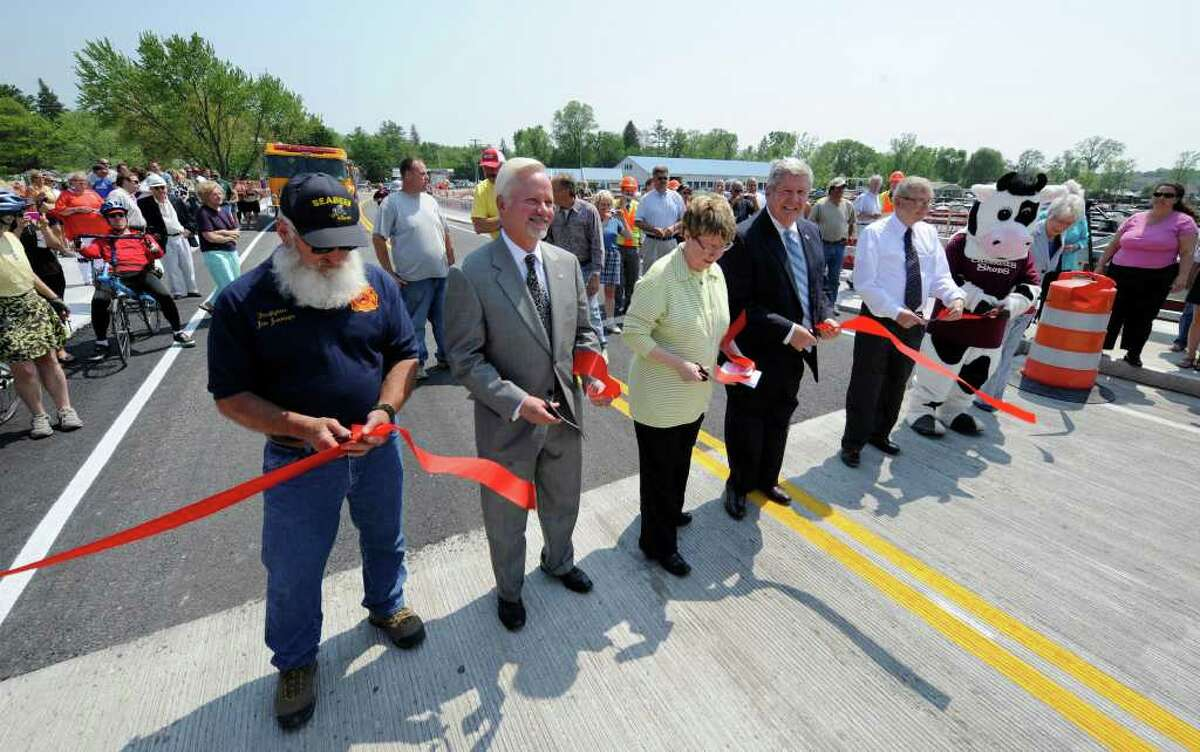 Local dignitaries cut the ceremonial red tape on the approach to the bridge at the opening of the Route 9P Bridge at the north end of Saratoga Lake May 26, 2011. (Skip Dickstein / Times Union)
