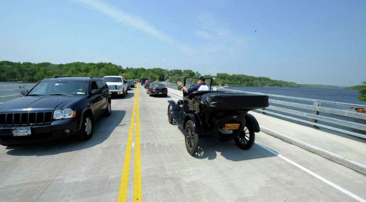 Peter Czelowanck drives his 1925 Model T Touring car across the bridge at the opening of the Route 9P Bridge at the north end of Saratoga Lake May 26, 2011. (Skip Dickstein / Times Union)