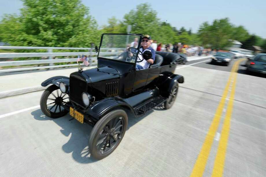 Peter Czelowanck drives his 1925 Model T Touring car across the bridge at the opening of the Route 9P Bridge at the north end of Saratoga Lake May 26, 2011.  (Skip Dickstein / Times Union) Photo: SKIP DICKSTEIN / 2008