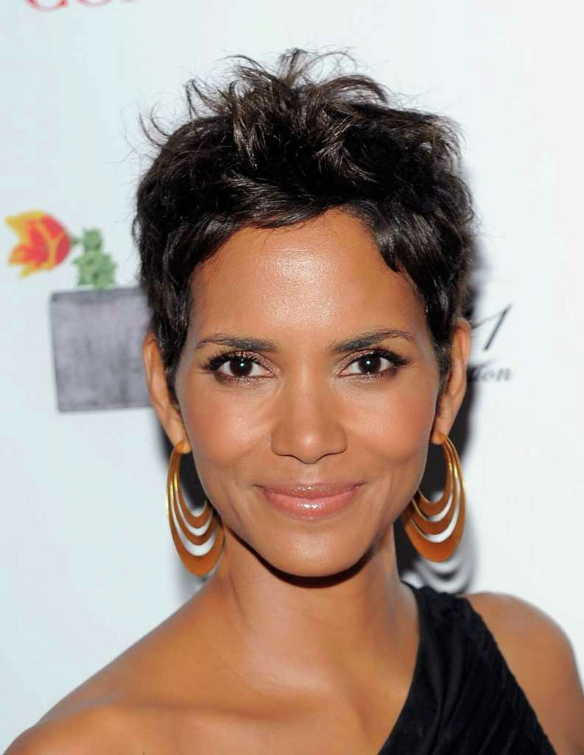 Actress Halle Berry poses backstage at the 2011 FiFi Awards at The Tent at Lincoln Center in New York City.