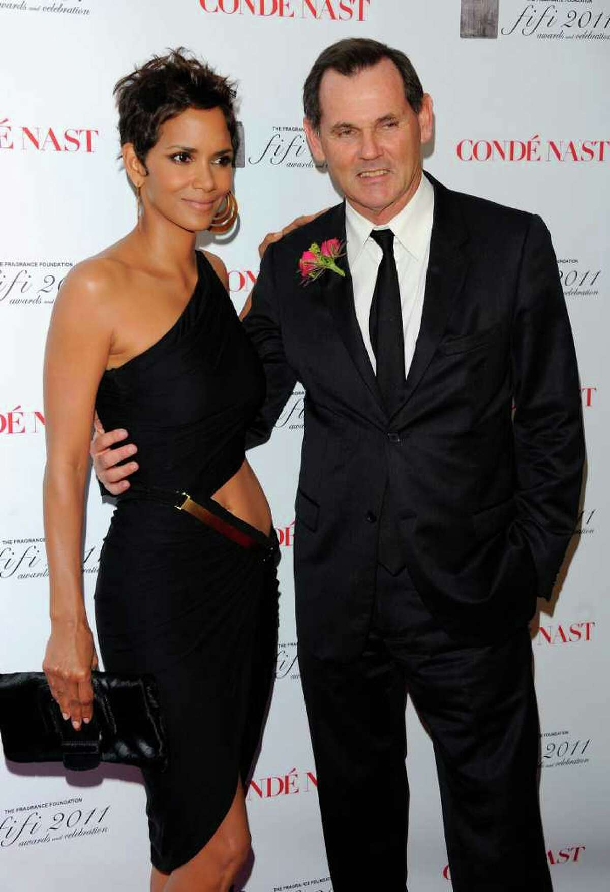Halle Berry and Coty Inc. CEO Bernd Beetz attend the 2011 FiFi Awards at The Tent at Lincoln Center in New York City.