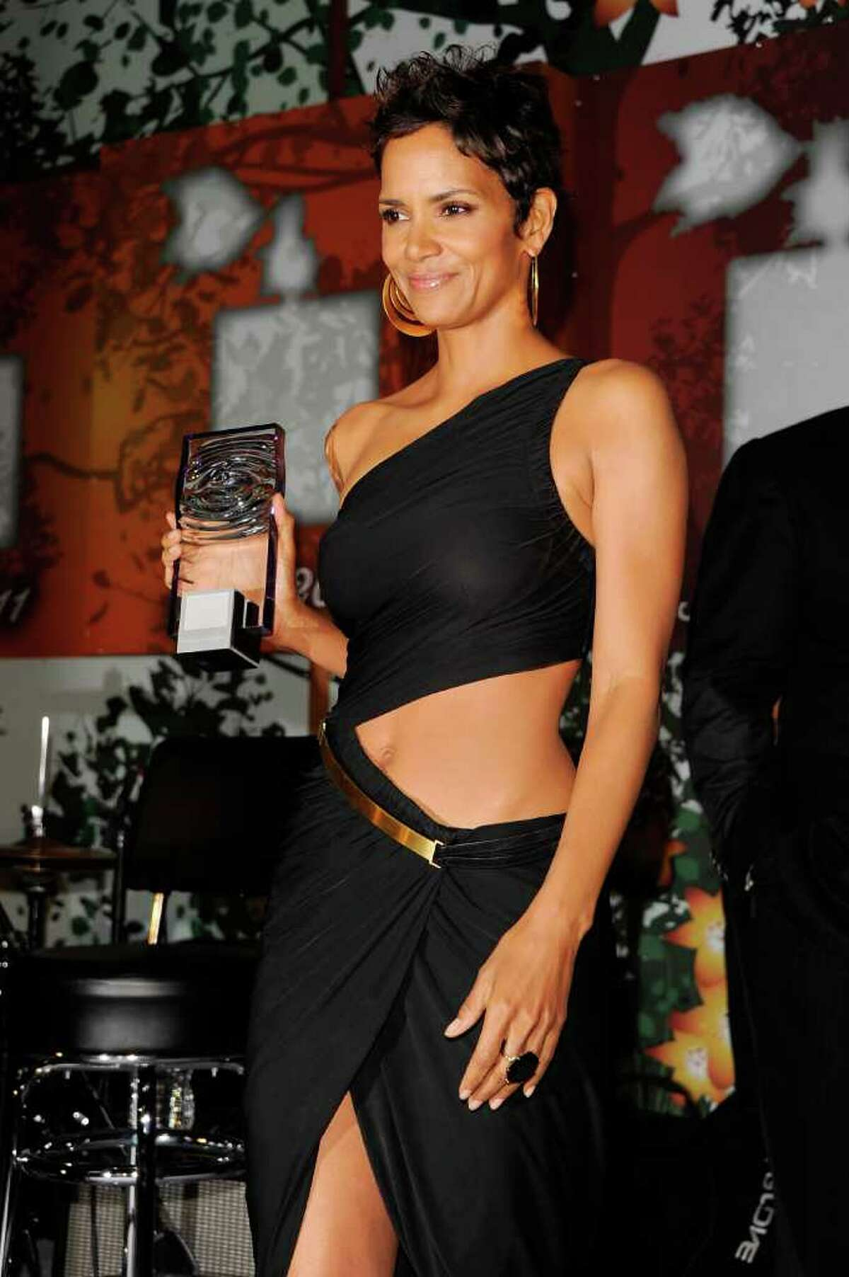 Actress Halle Berry accepts her award onstage during the 2011 FiFi Awards at The Tent at Lincoln Center in New York City.