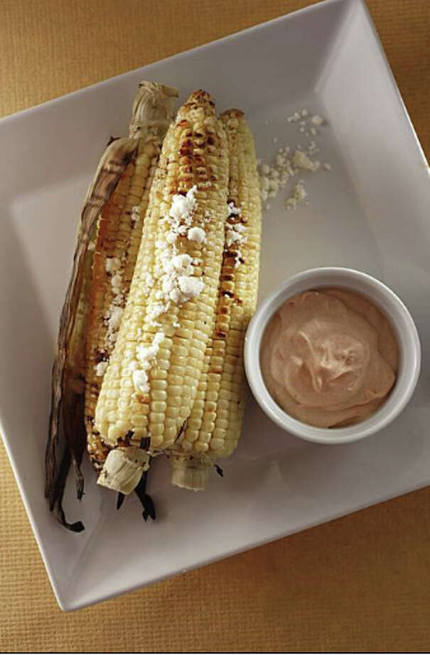 Grilled Corn on the Cob With Spicy Lime Creme Fraiche & Cotija Cheese: An upscale spin on the traditional Mexican street food. Recipe: http://www.sfgate.com/food/recipes/detail.html?p=detail&rid=18281&sorig=qs Photo: Craig Lee / Special To The Chronicle /  San Francisco Chronicle