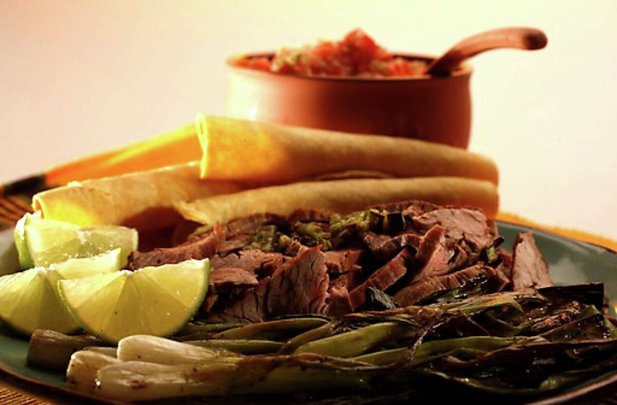 Beer-Marinated Flank Steak: Serve with warm corn tortillas, salsa, guacamole and grilled spring onions. Recipe: http://www.sfgate.com/food/recipes/detail.html?p=detail&rid=17188&sorig=qs
