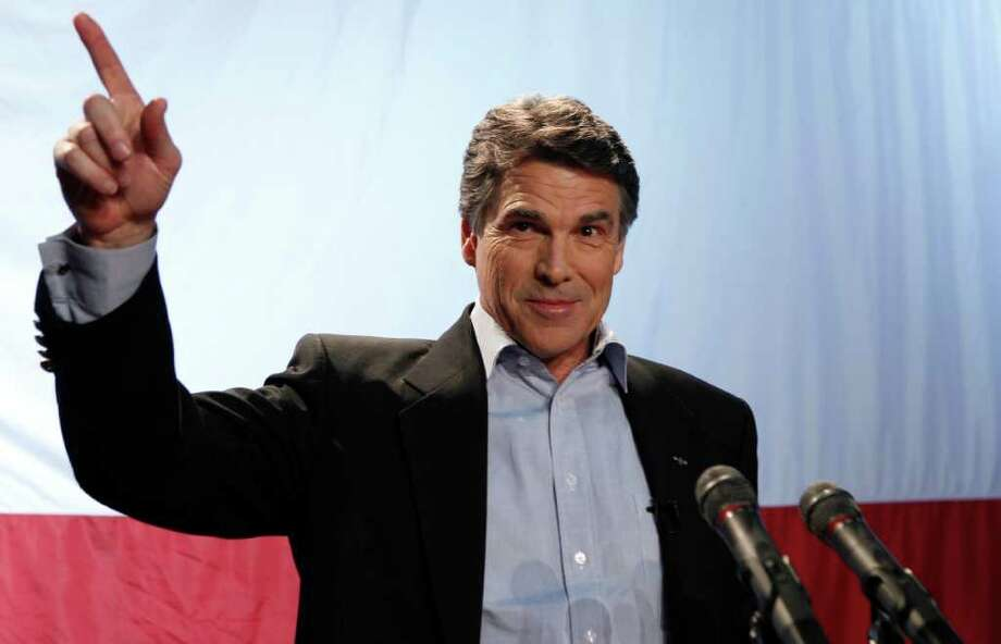 Texas Gov. Rick Perry speaks at his victory party in  Buda, Texas, Tuesday, Nov. 2, 2010.  (AP Photo/LM Otero) Photo: LM Otero, STF / AP