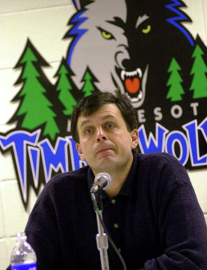 Minnesota Timberwolves vice president Kevin McHale listens to  a question during a news conference Friday, Dec. 8, 2000, in Minneapolis, where he announced an agreement with the NBA to take a leave of absence as punishment for an illegal deal with former player Joe Smith. McHale, whose duties are that of a general manager, is to have no formal contact with players or coaches and won't be involved in personnel decisions. He will return from the leave on Aug. 1. (AP Photo/Jim Mone).     HOUCHRON CAPTION (07/16/2002):  ``If Allen came to my house, he'd find out that I probably have five more guns than he has.'' - Minnesota Timberwolves vice president Kevin McHale, an avid hunter, on the Iverson saga.     HOUCHRON CAPTION (02/13/2005)  SECSPTS: McHALE'S ARMY: Kevin McHale will step out of the front office and into the coach's hot seat in Minnesota. Photo: JIM MONE, STF / AP
