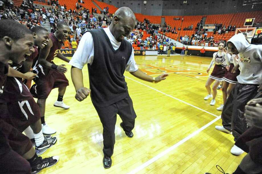 Silsbee head coach Travis Williams does a  victory dance on court after the Tigers defeated Hardin-Jefferson  53-50 during their Class 3A, Region III  basketball tournament final at Sam Houston State University. Silsbee will advance to the UIL state tournament next week.   Valentino Mauricio/The Enterprise Photo: Valentino Mauricio / Beaumont