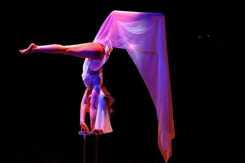 Hand balancer Elena Borodina performs her routine during a performance of Teatro Zinzanni's