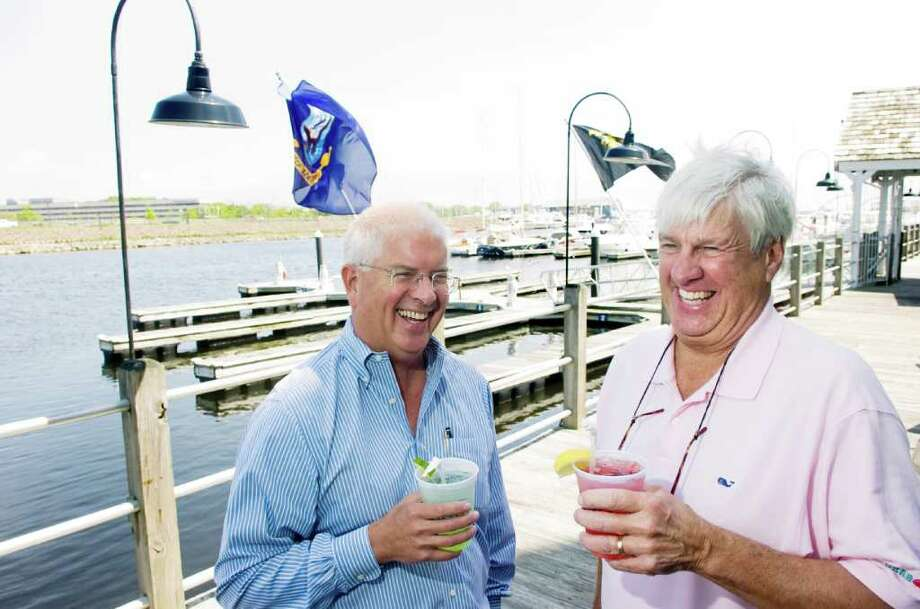 Paul Norton of the Young Mariners Foundation and Dick Gildersleeve owner of the Crab Shell Restaurant photographed in front of the restaurant at Stamford Landing in Stamford, Conn., May 19, 2011. Gildersleeve has organized a Memorial Day party which will take place on these docks and feature music, boats and good times for the benefit of the Mariners. Photo: Keelin Daly / Stamford Advocate