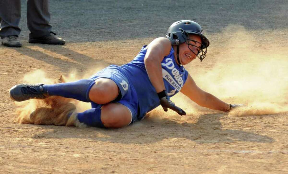 Darien's #7 Nicole Buch slid into home plate to bring in the winning RBI to win the game 4-3 over Fairfield Ludlowe, during the FCIAC girls softball final at Fairfield University in Fairfield, Conn. on Friday May 27, 2011.